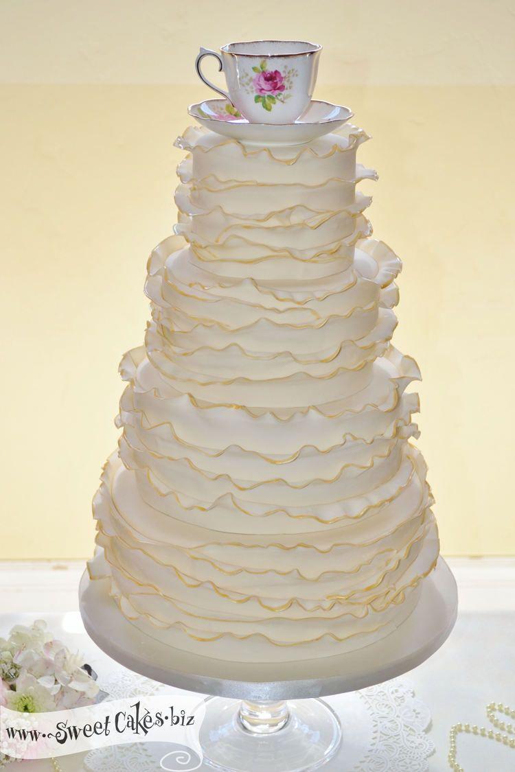 Tea Cup Wedding Cake 4 tier round ivory cake with ruffled fondant ...