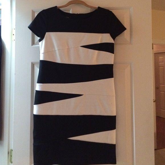 Black and White bandage dress NWT Black and white bandage dress, cap sleeve, NWT. Size 10 petite Dresses