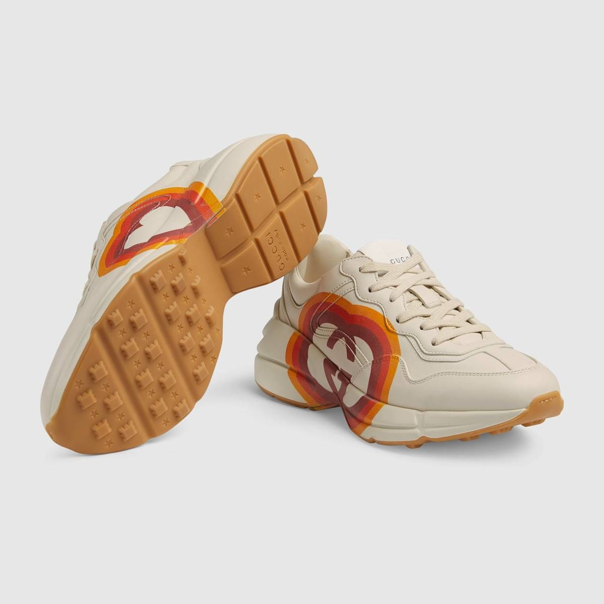 04dc356ea7a Shop the Rhyton sneaker with Interlocking G and heart by Gucci. Made up of  influences