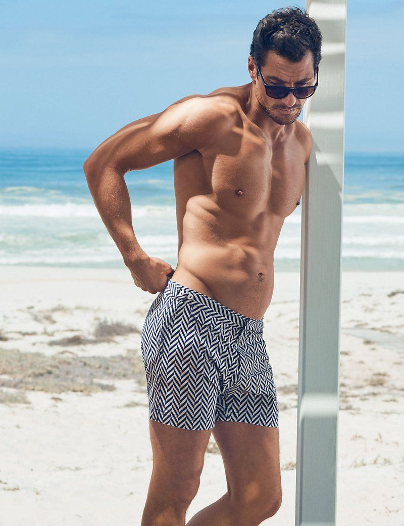 4d96305a1f15a David Gandy embraces a zigzag print, wearing his David Gandy for Autograph  Tailored Fit Mid Length Quick Dry Swim Shorts from Marks & Spencer.