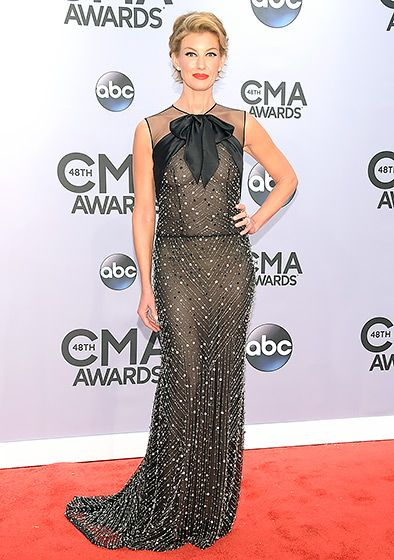 Faith Hill~Hill—accompanied by her husband, Tim McGraw—stunned in a semi-sheer Naeem Khan dress, tied at the neck with a big black bow.