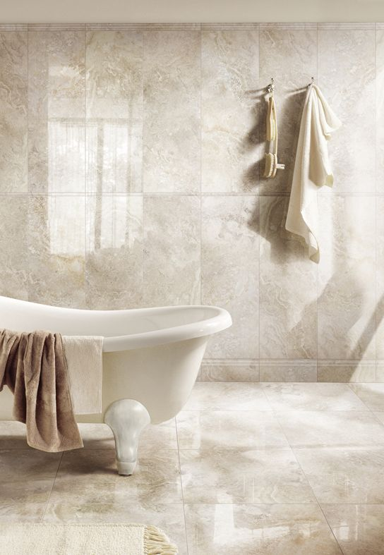 """shiny porcelain tiles - yes... For the floors - Matt....Matt Tiles will be best for bigger bathrooms and if you want to create a modern look in your bathroom. A matt tile won't need as much maintenance to keep it's """"new"""" look, and they don't need cleaning as often as gloss tiles do....Matt tiles also give off a """"natural"""" look, so you bathroom will look really appealing and authentic"""