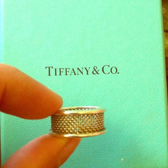 Authentic Tiffany & Co. Mesh ring Size 7. Too large for me, I wear a 6. A comfortable ring, not too bulky. I tried to get a clear picture of the Tiffany and co. Stamp on the rim of the ring. Tiffany & Co. Jewelry Rings