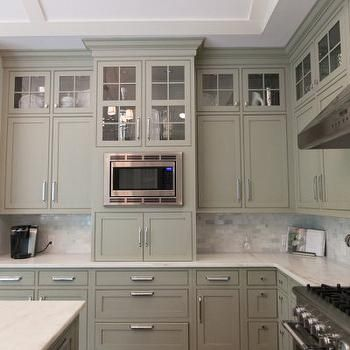 Gray Green Kitchen Cabinets Paired With Marble Mini Subway Tile Backsplash And Countertops