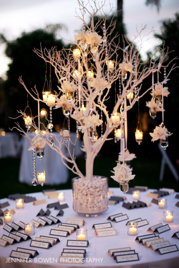 winter wonderland wedding table ideas%0A Credit  Brown Canada Weddings and Events   A closer look at the gorgeous  seating card table with a white tree and hanging candles  u     floral      Winter  Wedding
