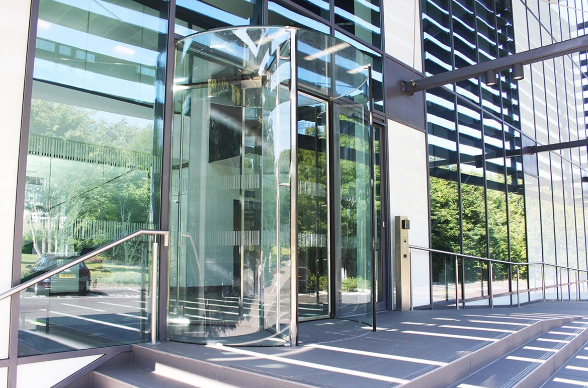All glass manual revolving door manufactured and installed by ea all glass manual revolving door manufactured and installed by ea group at the prestigious new office planetlyrics Image collections