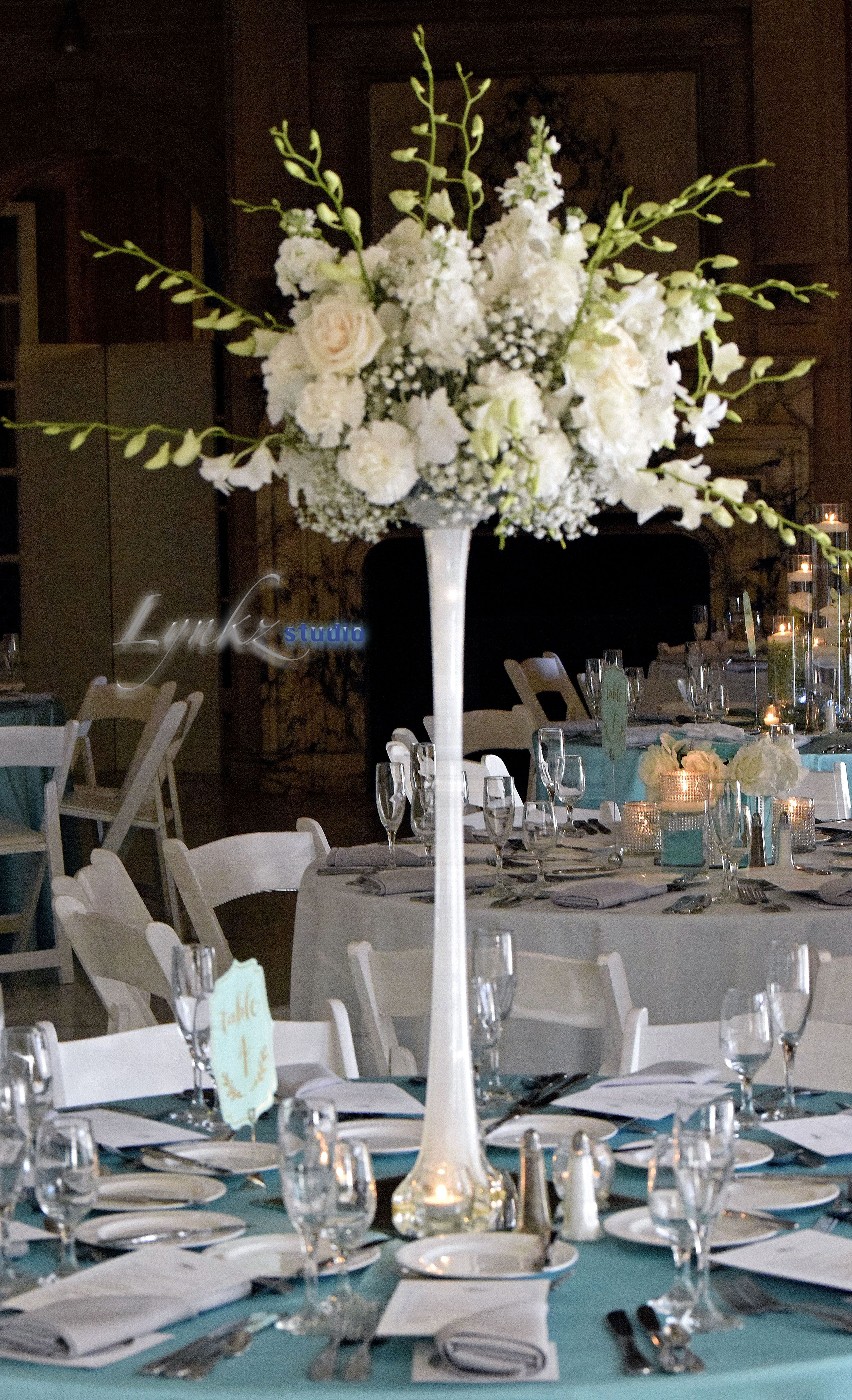 Guest Table Centerpiece On Eiffel Tower Vase With White Dendrobium