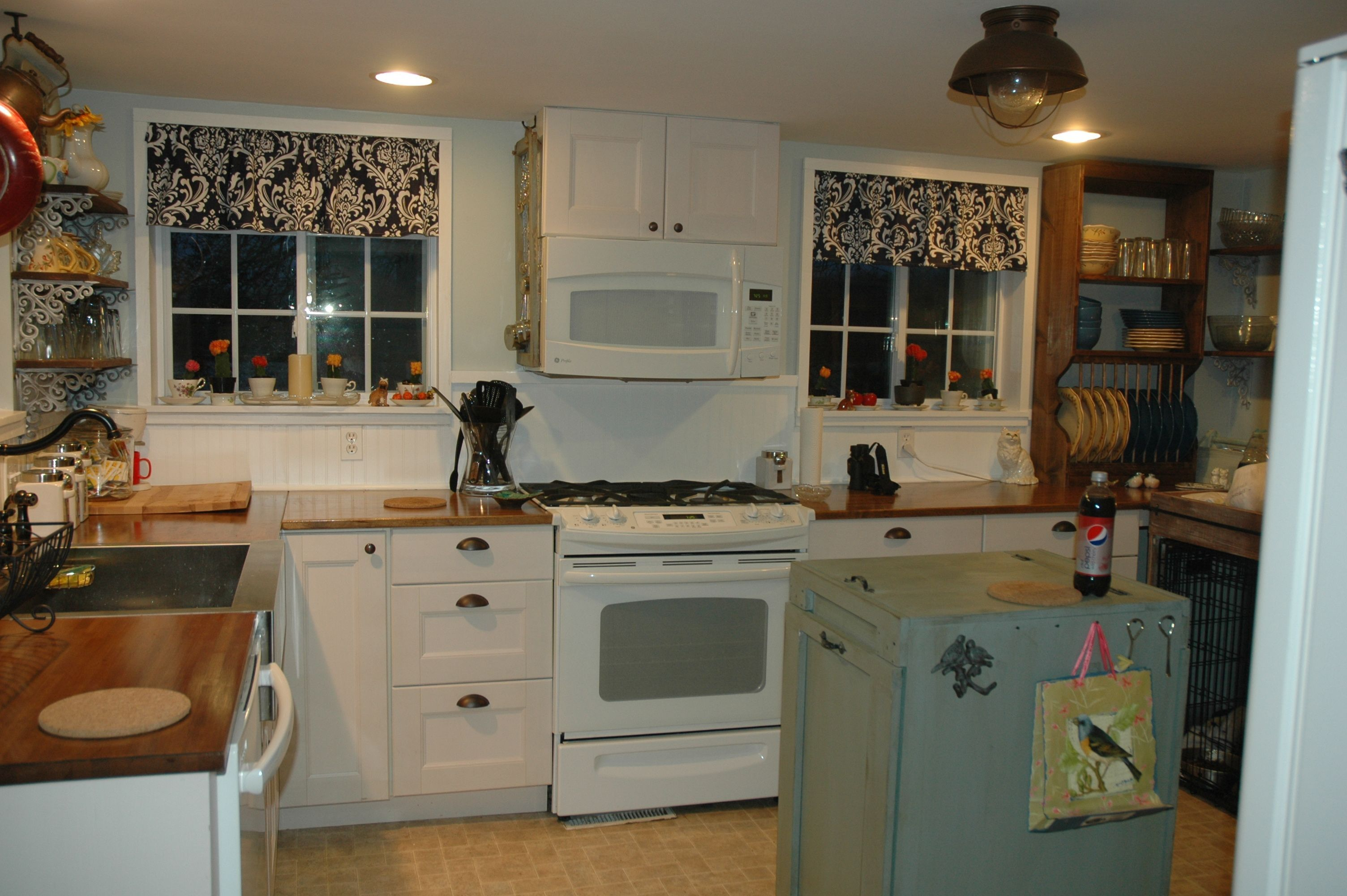 Wood counters beadboard backsplash open shelving plate rack tilt