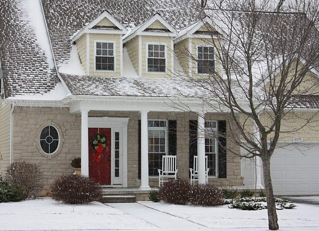 Stone siding red door and front porch though i prefer for Houses with porches all the way around