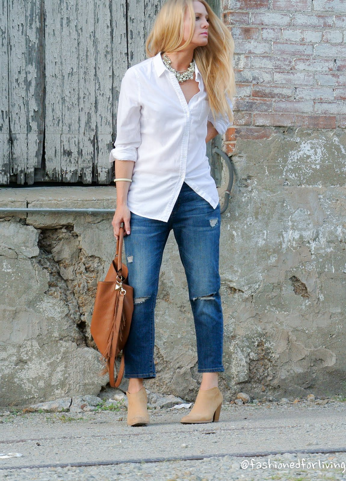 567afc5364a12 cropped jeans outfit with white button up, mules, and fringe bag. Clark  Hobo. DV Nya Booties.