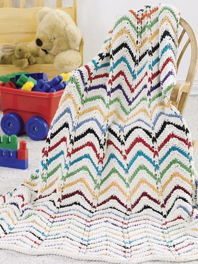 The Winterfest Afghan features a colorful chevron pattern ...