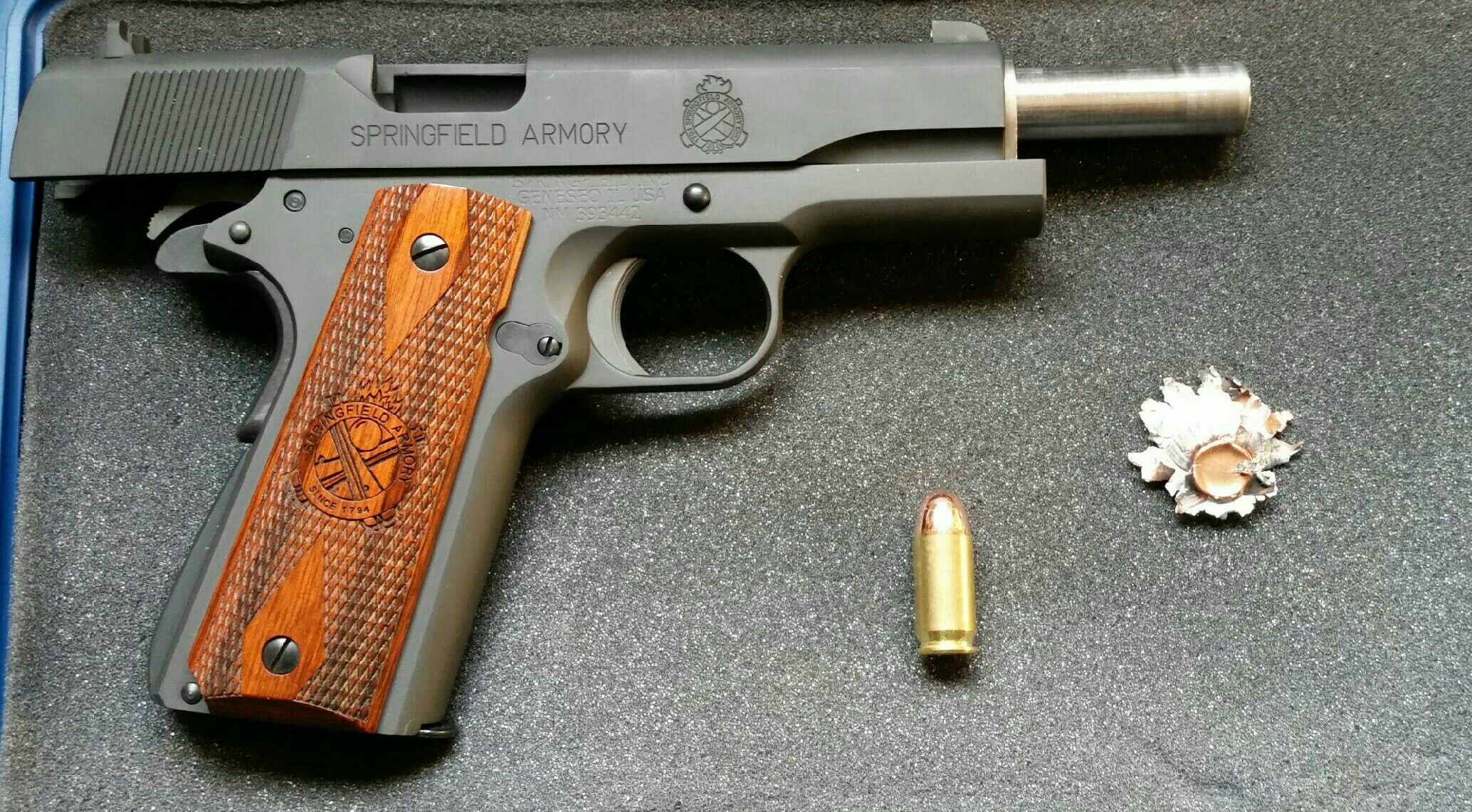 My Springfield Armory 1911A1. With a .45 .a.c.p cartridge next to it and an impacted round that I dug out of the old water heater.