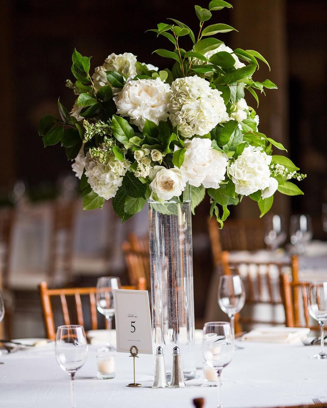 Lush green and white tall centerpiece at devil s thumb