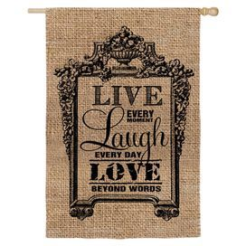 """Pairing country-chic burlap with a vintaged scrolling motif, this lovely garden flag welcomes guests to your home in chic style.  Product: Garden flagConstruction Material: Burlap and cottonColor: Brown and blackDimensions: 43"""" H x 29"""" WNote: Pole not included"""