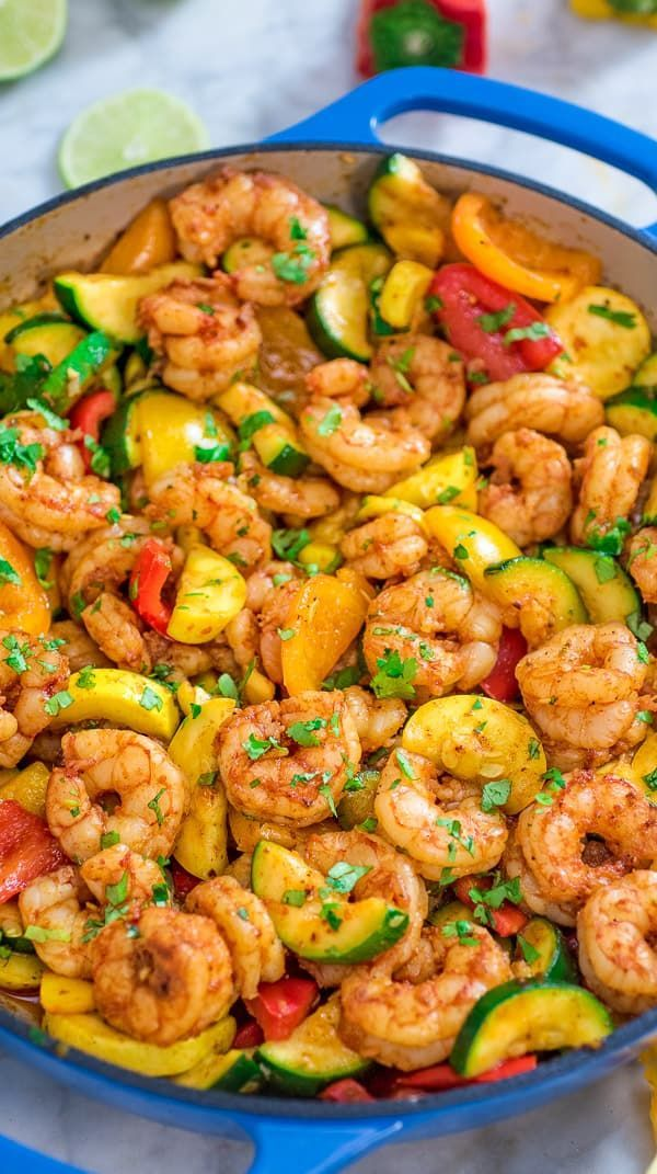 This Easy Shrimp and Vegetable Skillet makes a healthy, quick, and delicious dinner! Packed with wild-caught shrimp, tender zucchini, and sweet bell peppers, it is going to become your favorite seafood dish! #recipe #shrimps #seafood #dinner #lunch #mealprep #dishesfordinner