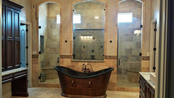 Modern home with bath, granite, freestanding, travertine, and ...