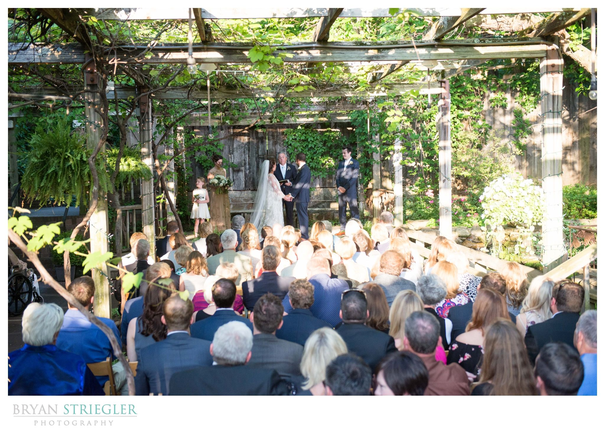 Wide view of the outdoor wedding ceremony at The Garden Room