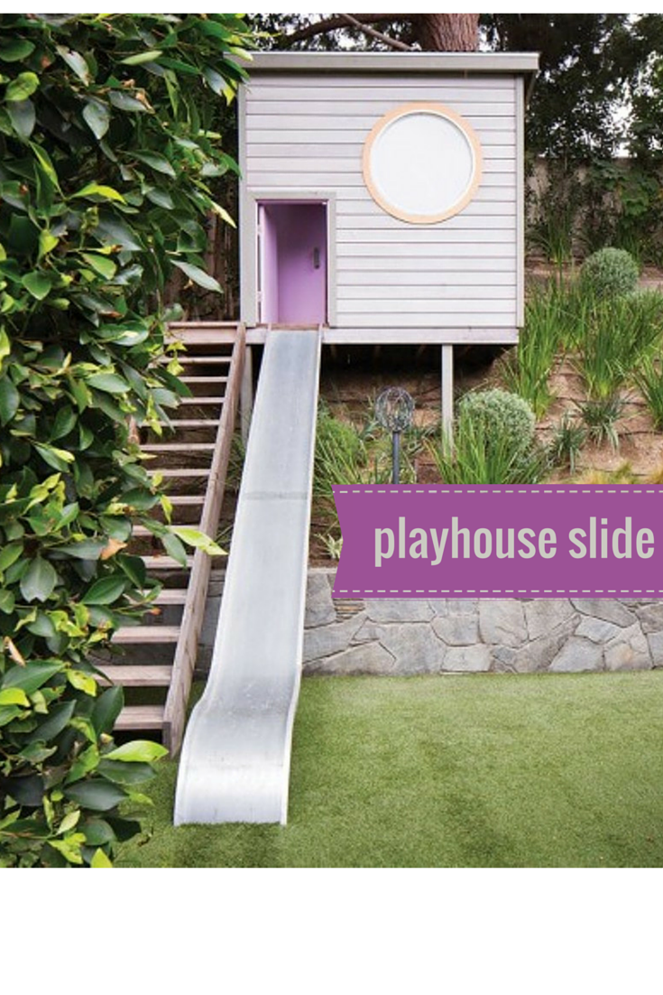 a backyard playhouse with a cool slide