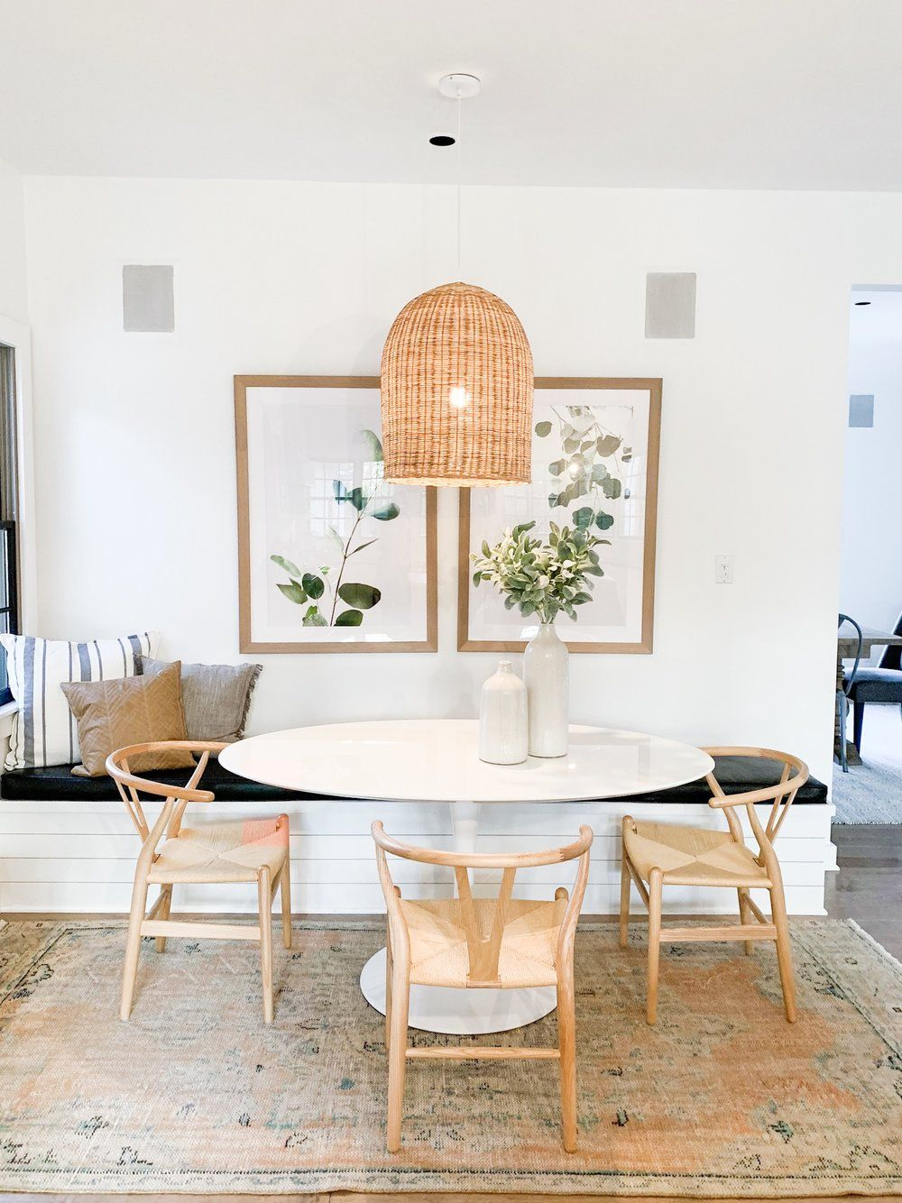Pendant Light Over White Oval Table And Wishbone Chairs Dining