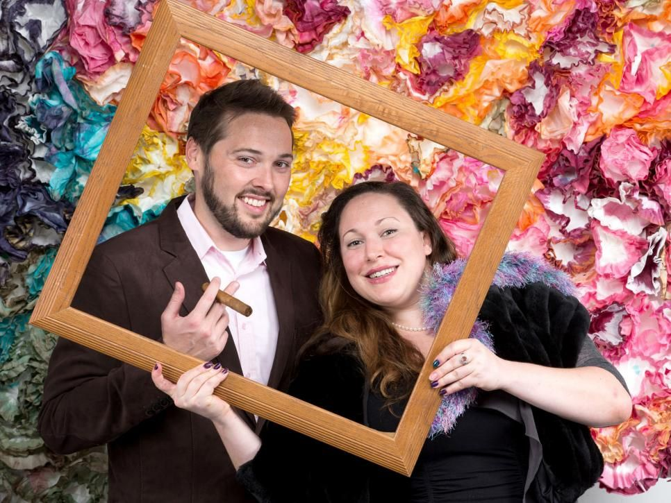 Your guests got all dolled-up, so let them have their own photo op. This DIY photo booth will save you a bundle, no rentals required. (Don't forget the silly props! We've got templates for those, too.)