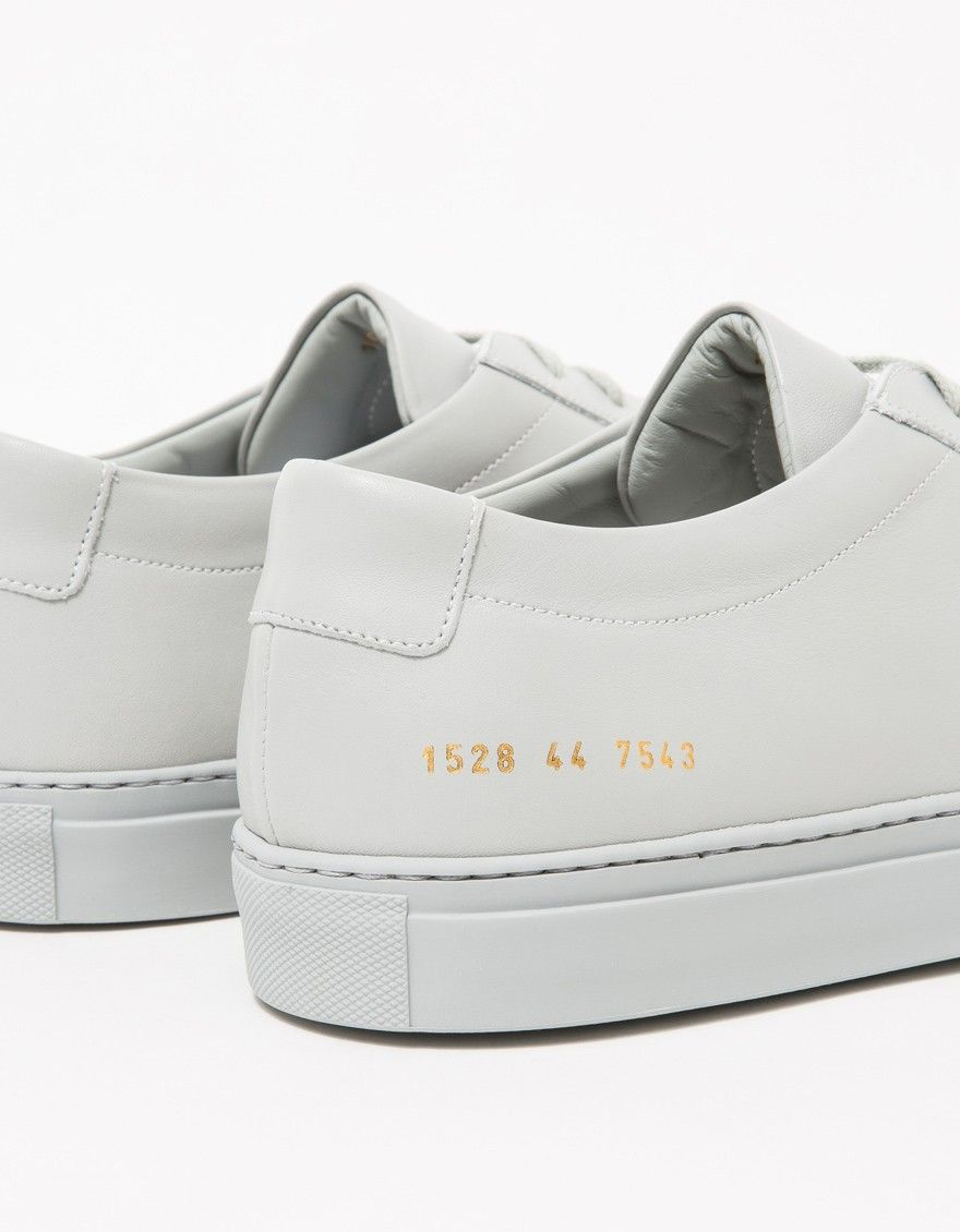 caa177783e96c Low top sneaker from Common Projects in Grey. Lace-up front with flat  laces. Lightly padded tongue and collar. Leather lining. Heat pressed gold  serial ...