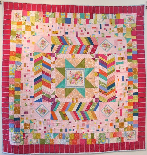 Carousel by Anna Carloni with Terri Carpenter, Chancy Fessler, Valerie Gibbins. Quilted by Terri Carpenter.