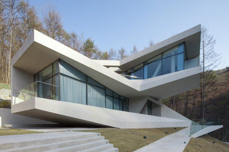 Maison béton design architecture moderne fenetres panoramiques