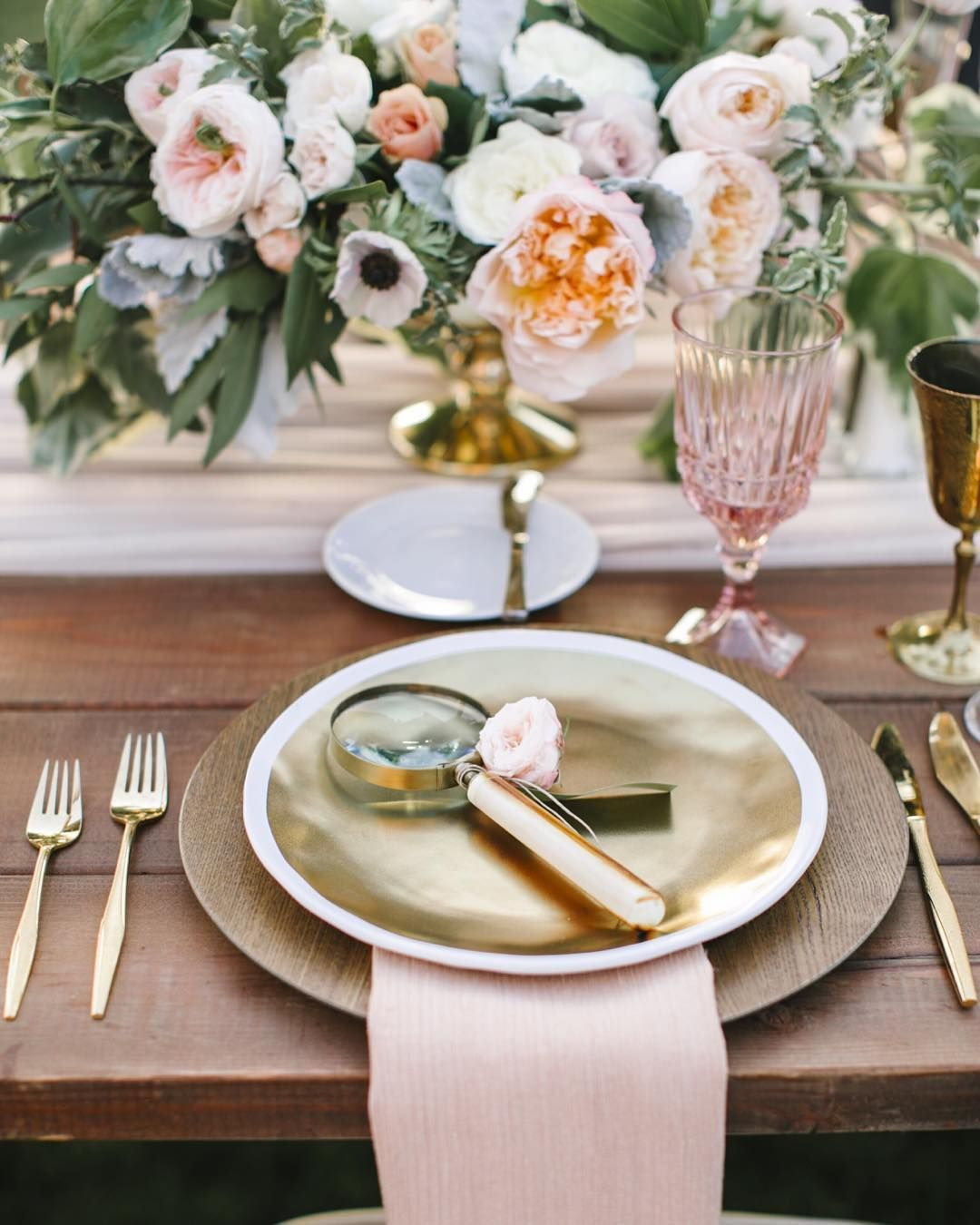 There is an extra sweet story behind this beautiful tabletop! When our bride lost her engagement ring (an heirloom from her grandmother) during a day at the beach her fiancé searched the sand until sunset finally finding it to bring home to her. Magnifying glasses at each place setting were the perfect touch to symbolize this couples buried treasure story. -@amorology #WWDayinTheLife {Photo: @joshelliott; Florals: @oakandtheowl; Rentals: @hostesshaven} by weddingwire