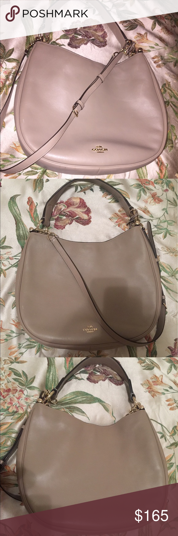 Coach large nomad hobo Used for a week. It's on the coach site for $495 plus tax. Inside the bag it has some discoloration bc of tape. On the handle it has a very small pink stain. Excellent condition. Very beautiful. Coach Bags Hobos