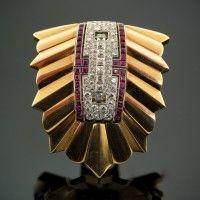 An Oscar Heyman gold brooch with a detachable ruby & diamond centre