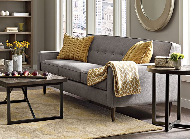Cant Get Enough Of The Modern Giselle Sofa Draped With Gold Accents Boston InteriorsLiving Room