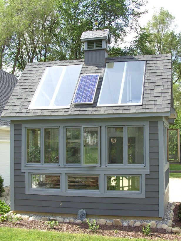 Powered By The Sun This Charming Greenhouse Uses Solar Energy For The Exhaust Fan Ceiling Fan And Lights Recycle Greenhouse Hardscape Design Greenhouse Shed