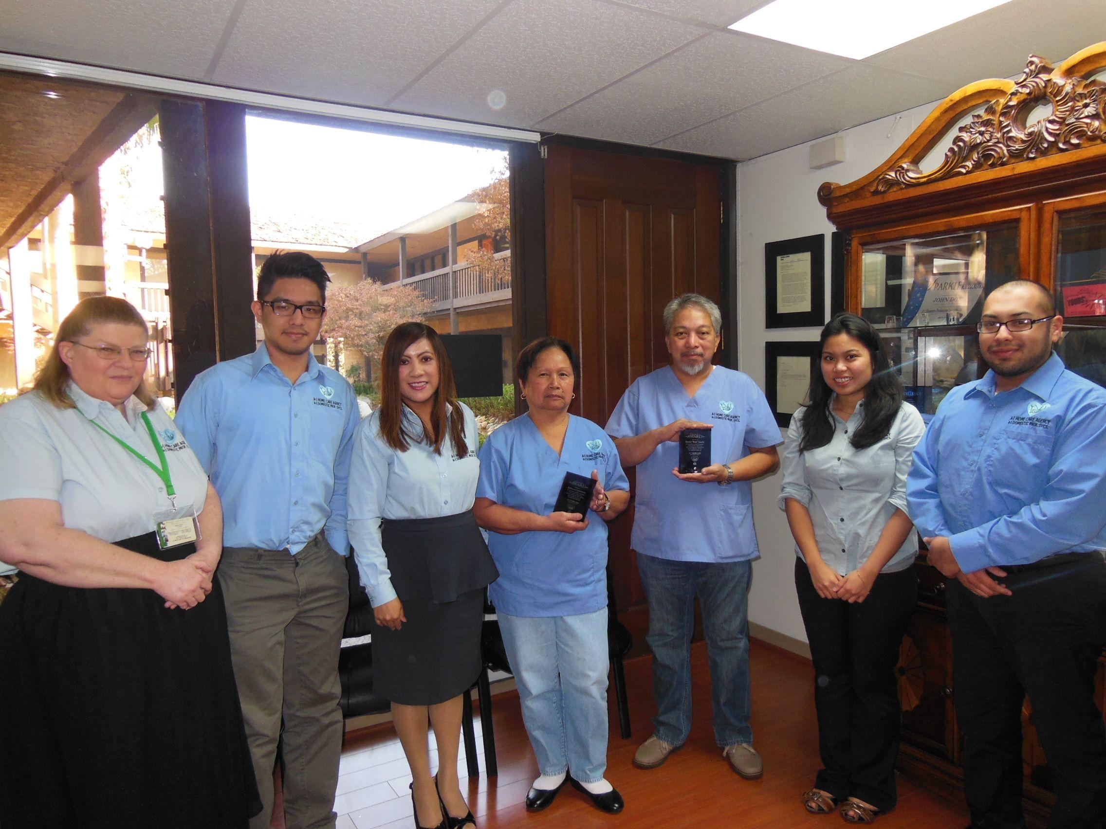 Our Staff Congratulating Enrico Caedo And Rebecca Cashmore