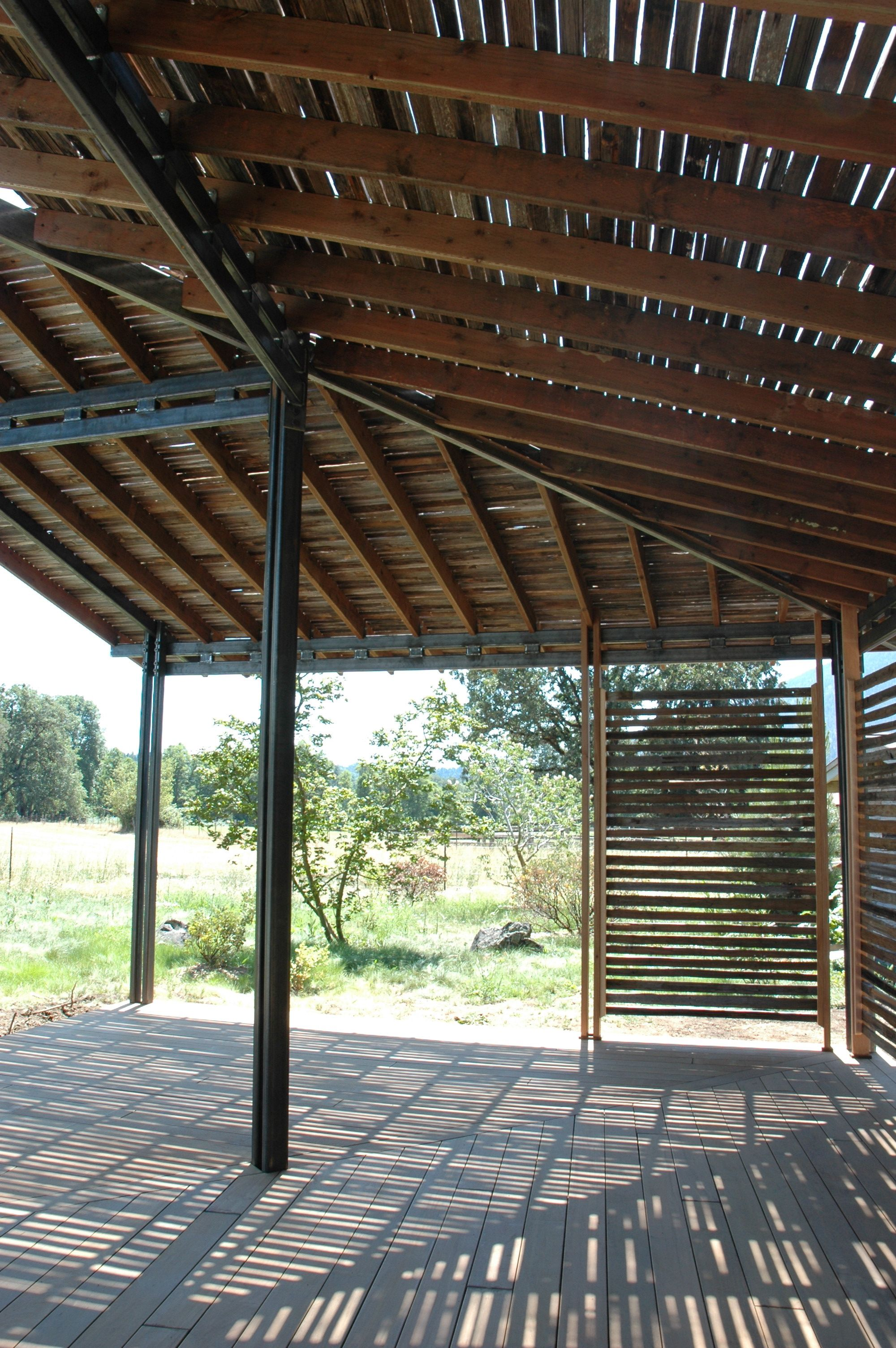 ramada style shade structure with steel framing and recycled redwood ...