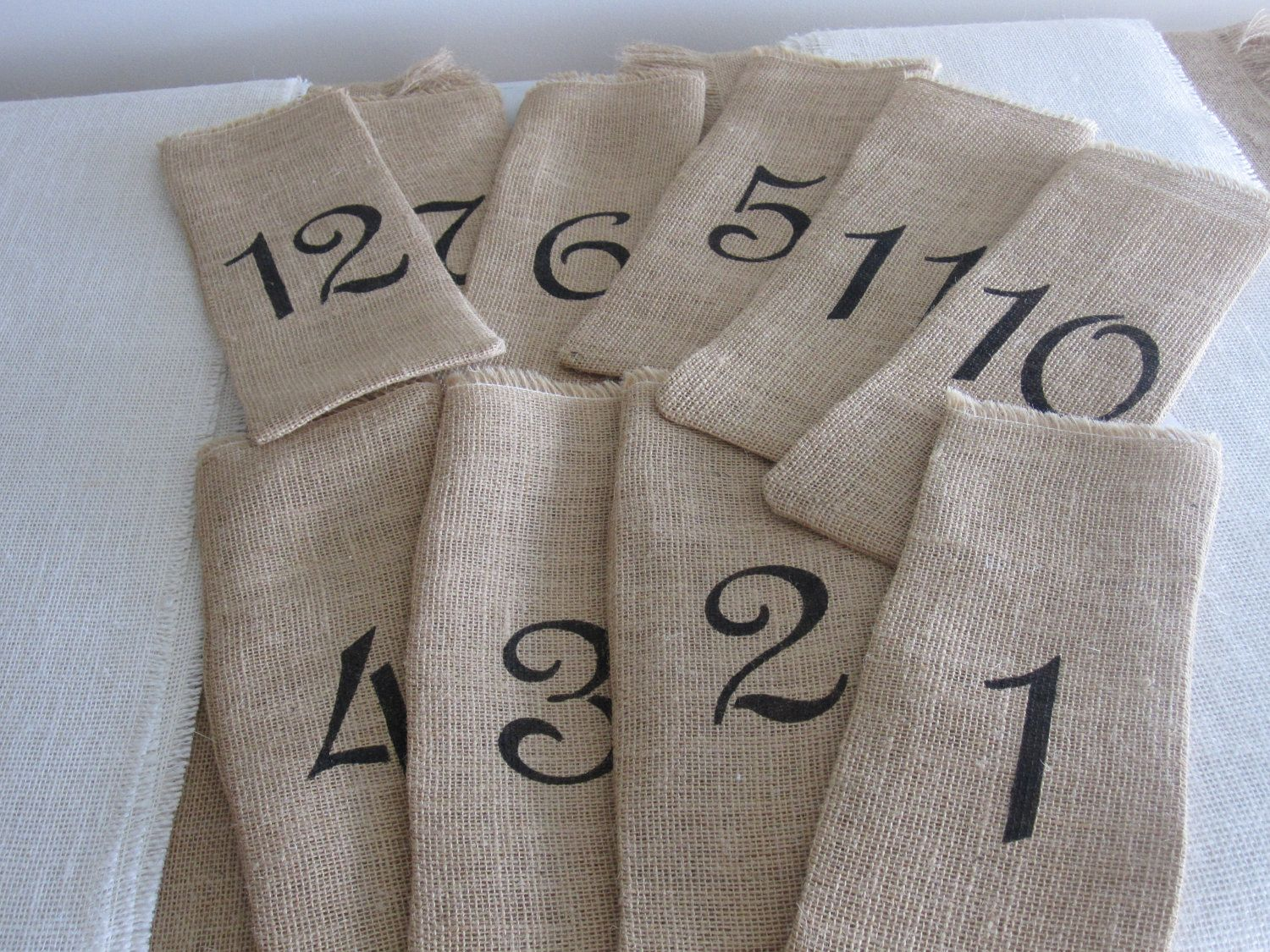 Burlap wine bags with hand stenciled numbers perfect for your