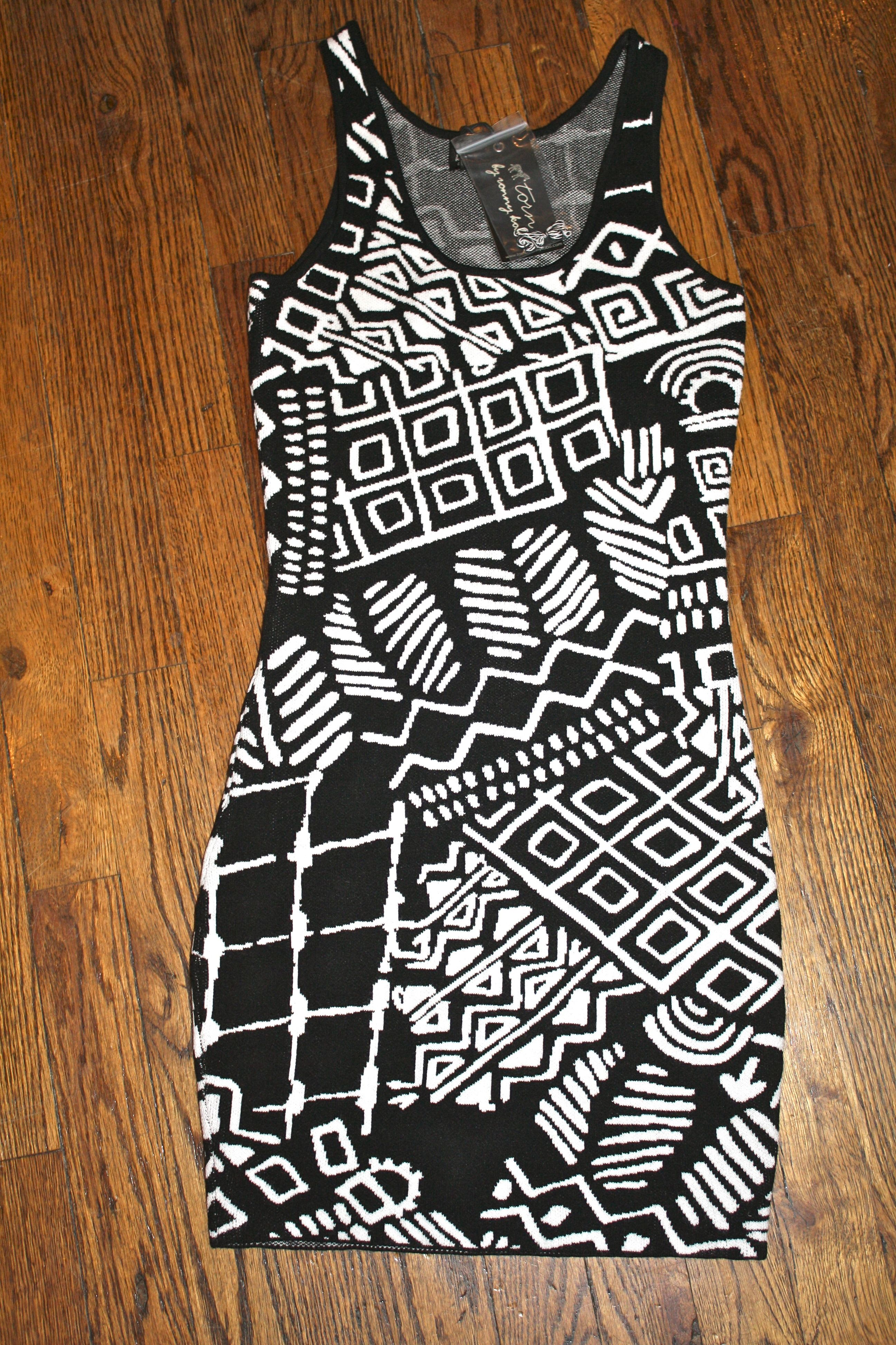 "Black/White Tribal Sleeveless Dress by Torn by Ronny Kobo ($59). Size XS.     For more information, e-mail thriftshare@gmail.com with the subject line ""Black/White Tribal Sleeveless Dress by Torn""."
