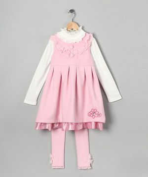 Sweet and girly, this set features a frock with delicate ruffles, classic pleats and a sweet flower detail. A girly shirt with a neckline full of frills adds charm, while matching stretchy leggings boast cozy construction and an elastic waistband for all-day comfort.