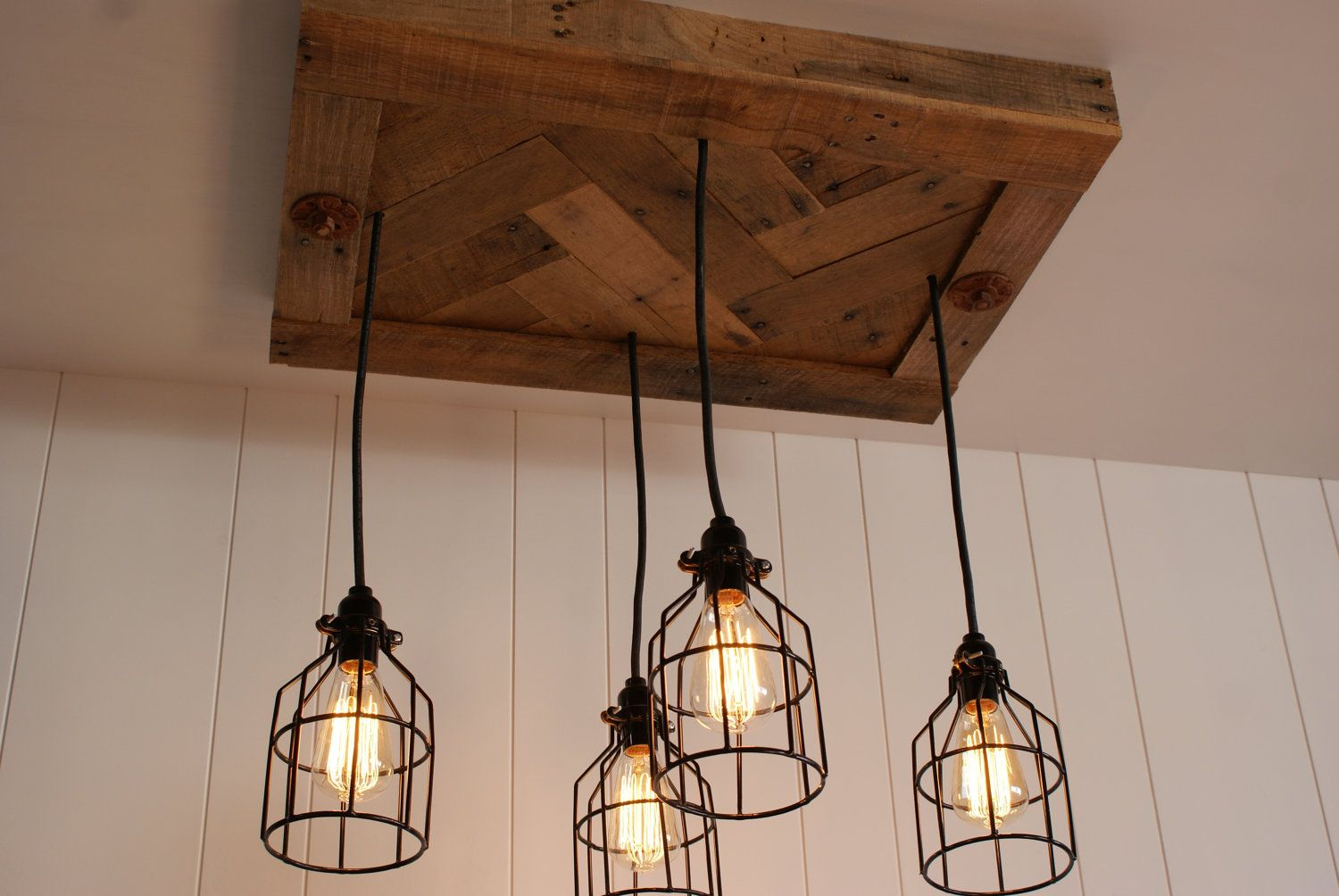 upcycled wood chandelier with cage lighting and vintage edison light