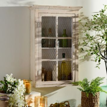 The Distressed Ivory Wall Cabinet |is perfect for your kitchen, laundry room or living room! #Kirklands #farmhouse