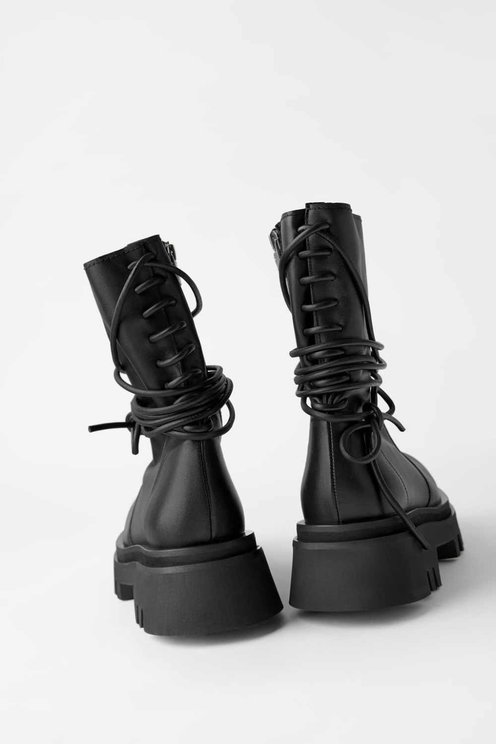 LEATHER TIED TRACK SOLE ANKLE BOOTS