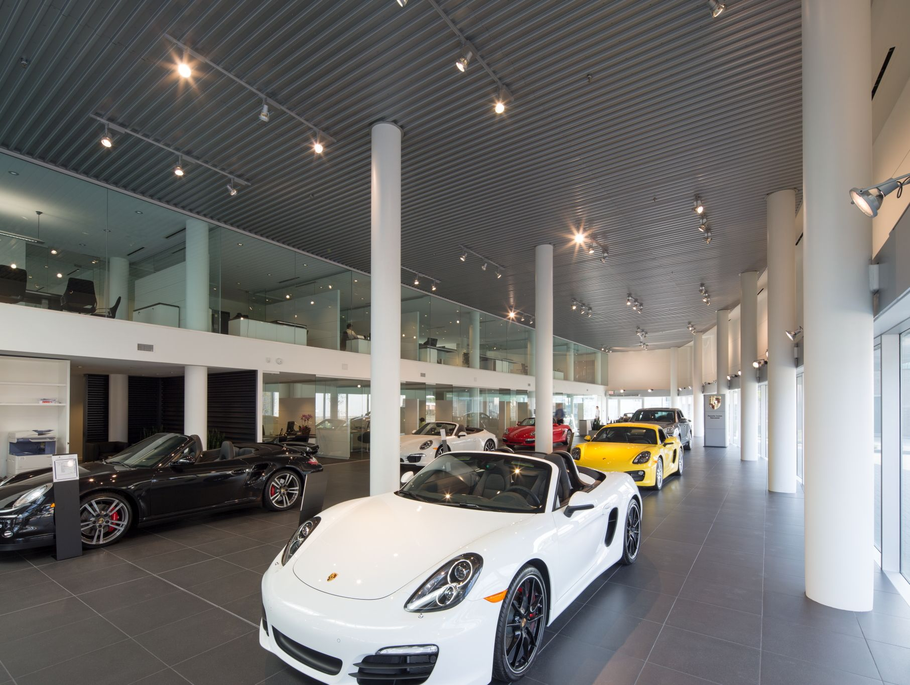 Porsche Centre Vancouver - features a large modern showroom, a ...