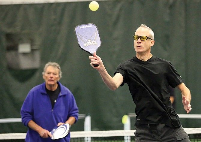 Brad Stiff, right, alongside doubles partner Phil Street, plays a friendly game of pickleball last winter at Tennis Center at Steamboat Springs. Pickleball continues to gain traction in Steamboat Springs, and last summer the city and Steamboat Pickleball association worked together to  converted a clay court into eight new pickleball courts.