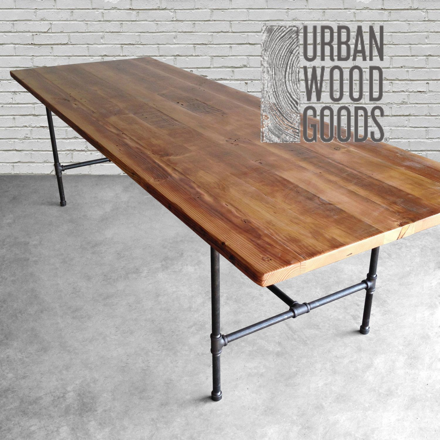 Wood dining table made with reclaimed wood top and iron pipe legs