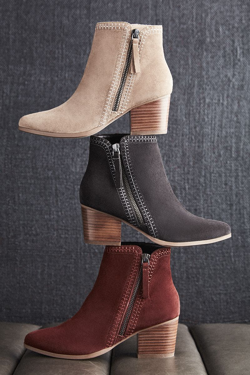 ba80d4f44fd4 Suede ankle booties with diagonal side zippers and contrast stitching