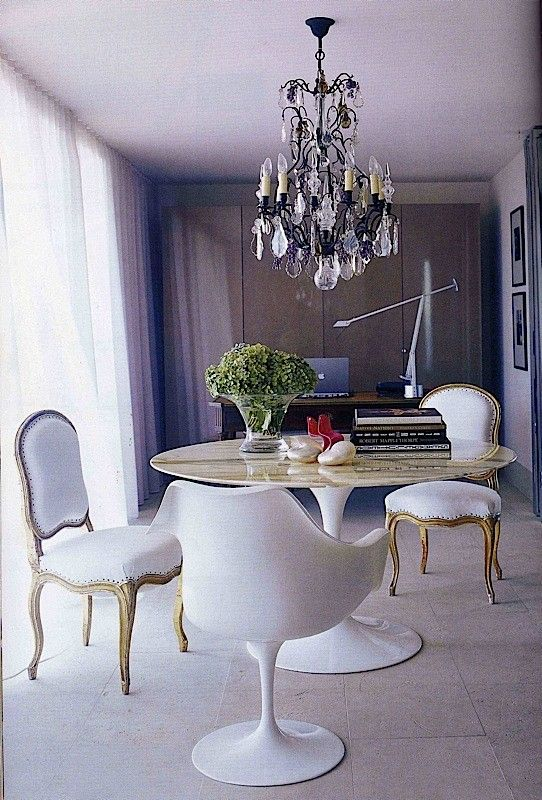 Love the Saarinen table with the Louis XVI antique chairs Antique