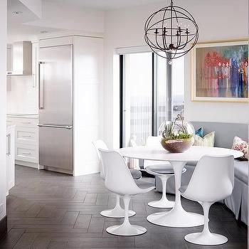 Corner Dining Nook With Freestanding Gray Curved Dining Banquette And Oval  Saarinen Dining Table