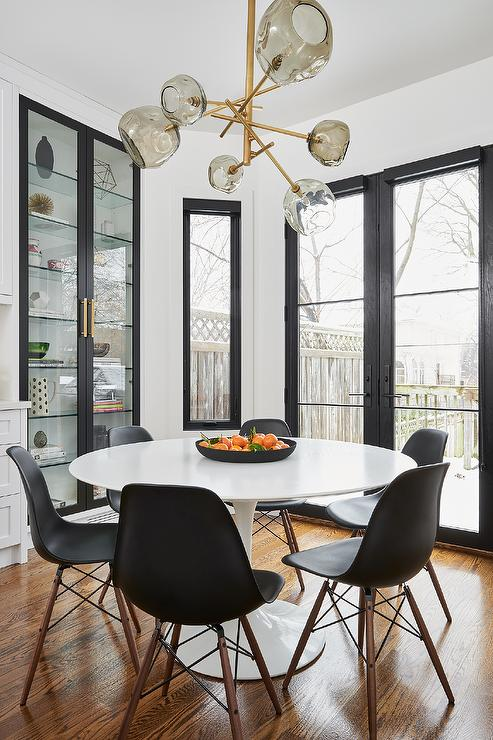 Ikea Docksta Table with Black Molded Plastic Chairs – Transitional – Dining Room