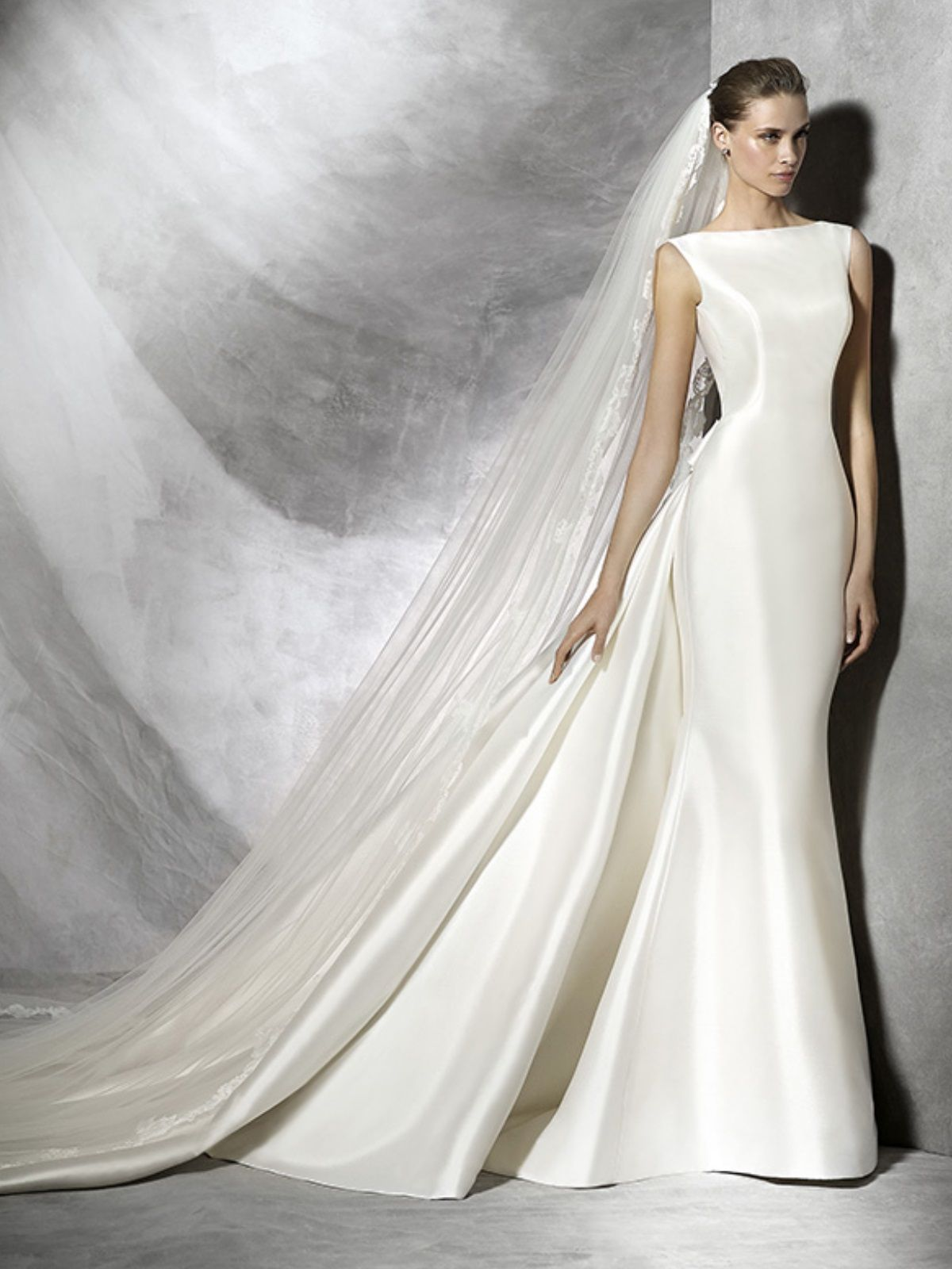 Sheath mikado satin wedding gown with a dropped back u bow detail