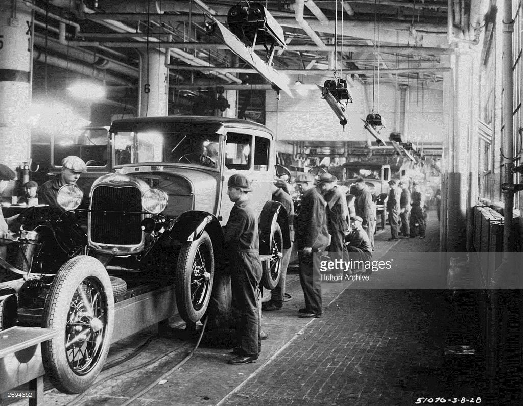 Assembly Line Workers Inside The Ford Motor Company Factory At