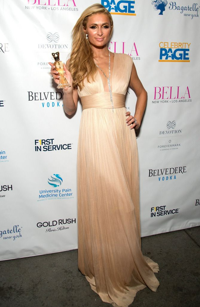 Paris Hilton in a plunging champagne dress